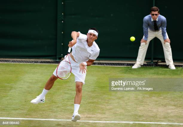 Australia's Bernard Tomic in action against Belgium's David Goffin during day two of the 2012 Wimbledon Championships at the All England Lawn Tennis...