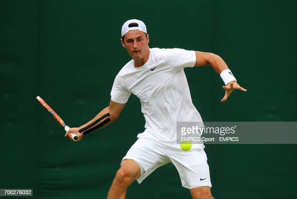 Australia's Bernard Tomic in action against Russia's Evgeny Donskoy