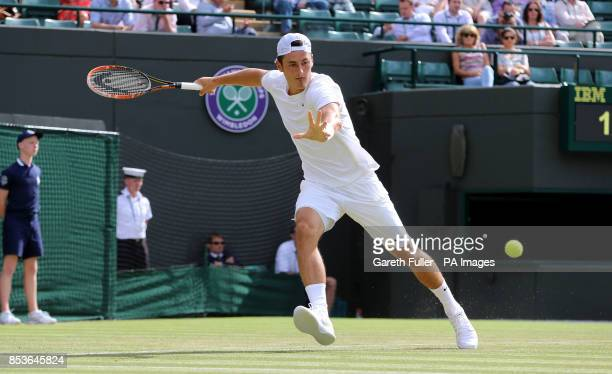 Australia's Bernard Tomic in action against Tomas Berdych during day three of the Wimbledon Championships at the All England Lawn Tennis and Croquet...