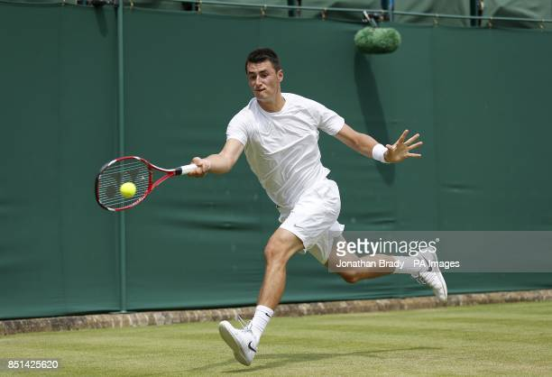 Australia's Bernard Tomic in action against USA's James Blake during day four of the Wimbledon Championships at The All England Lawn Tennis and...