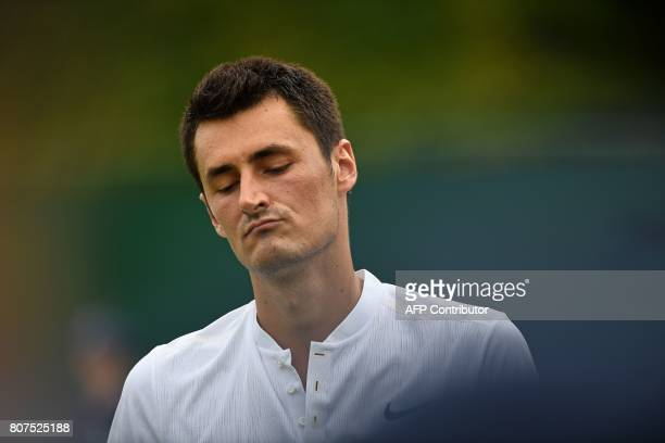Australia's Bernard Tomic reacts against Germany's Mischa Zverev during their men's singles first round match on the second day of the 2017 Wimbledon...