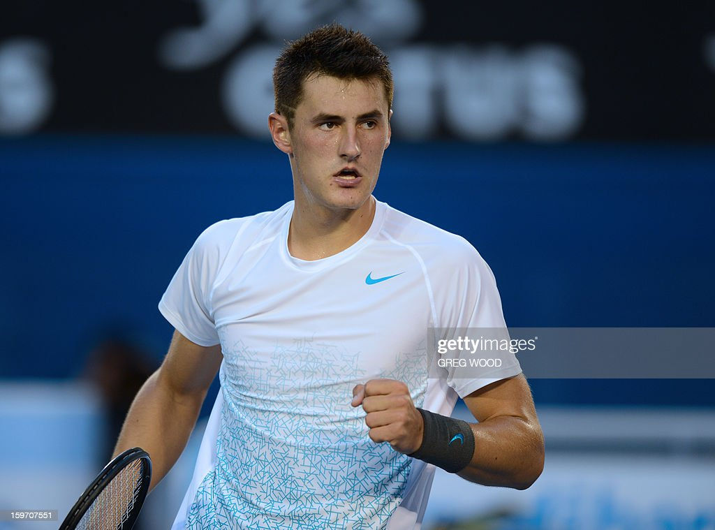Australia's Bernard Tomic reacts during his men's singles match against Switzerland's Roger Federer on the sixth day of the Australian Open tennis tournament in Melbourne on January 19, 2013. AFP PHOTO/GREG WOOD IMAGE STRICTLY RESTRICTED TO EDITORIAL USE - STRICTLY NO COMMERCIAL USE