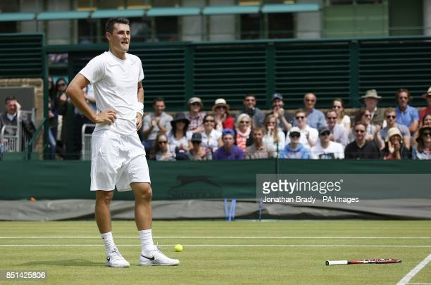 Australia's Bernard Tomic reacts to a decision made by the umpire during a match against USA's James Blake during day four of the Wimbledon...