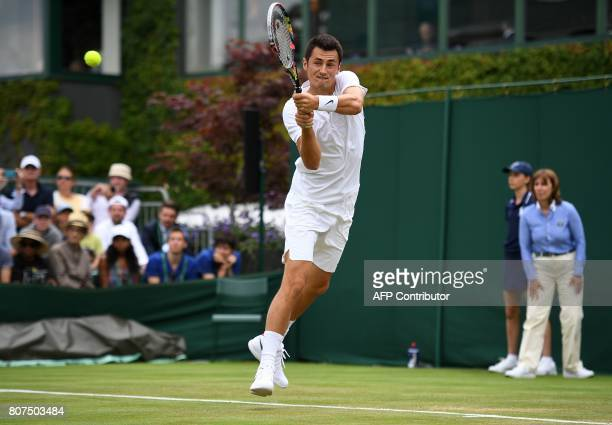 Australia's Bernard Tomic returns against Germany's Mischa Zverev during their men's singles first round match on the second day of the 2017...