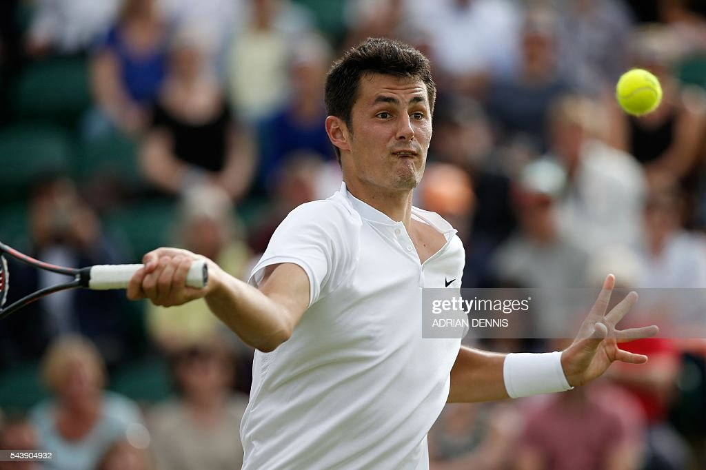 Australia's Bernard Tomic returns against Moldova's Radu Albot during their men's singles second round match on the fourth day of the 2016 Wimbledon Championships at The All England Lawn Tennis Club in Wimbledon, southwest London, on June 30, 2016. / AFP / ADRIAN