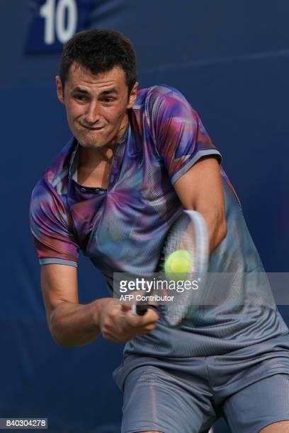 Australia's Bernard Tomic returns the ball to Luxemburg's Gilles Muller during their Men's Singles match at the 2017 US Open Tennis Tournament on...
