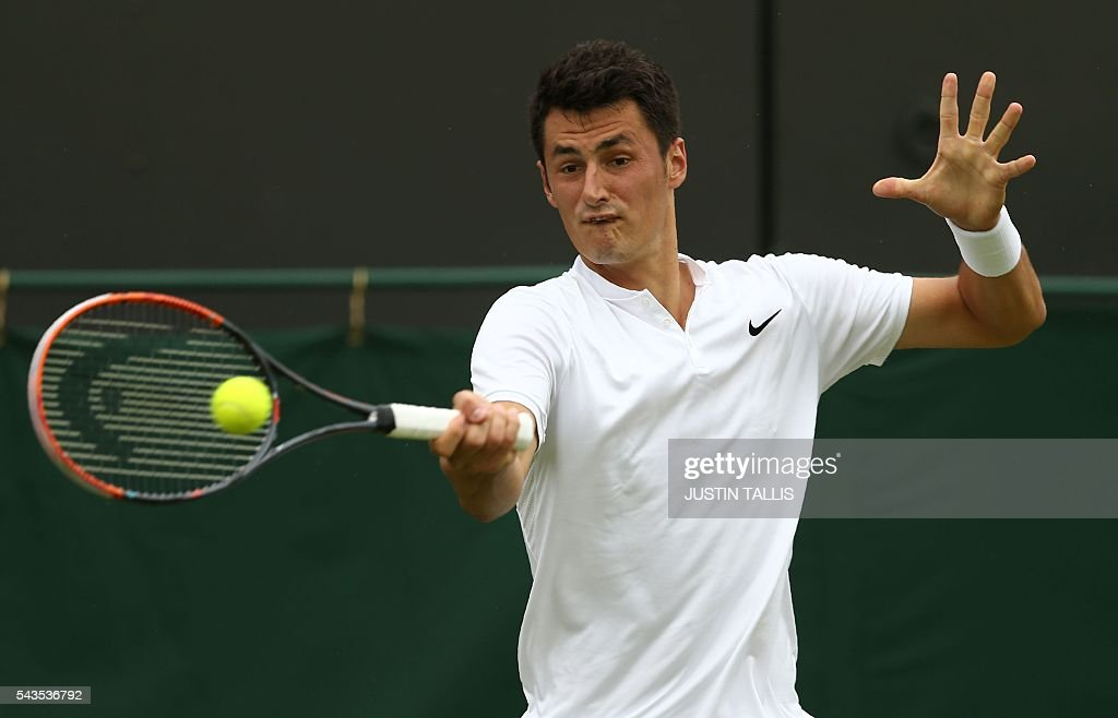 Australia's Bernard Tomic returns to Spain's Fernando Verdasco during their men's singles first round match on the third day of the 2016 Wimbledon Championships at The All England Lawn Tennis Club in Wimbledon, southwest London, on June 29, 2016. / AFP / JUSTIN