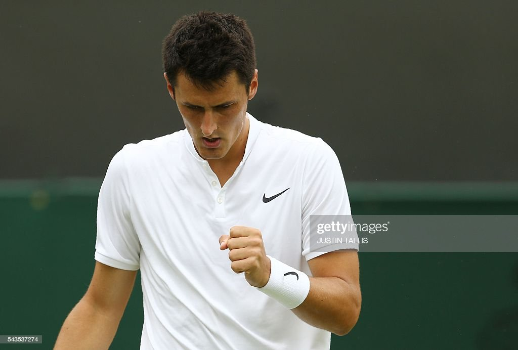 Australia's Bernard Tomic wins a point against Spain's Fernando Verdasco during their men's singles first round match on the third day of the 2016 Wimbledon Championships at The All England Lawn Tennis Club in Wimbledon, southwest London, on June 29, 2016. / AFP / JUSTIN