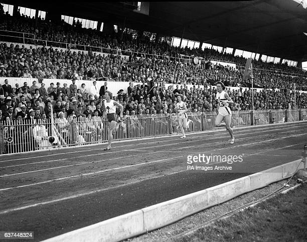 Australia's Betty Cuthbert wins the first semi final of the women's 220yds from Great Britain's Heather Armitage