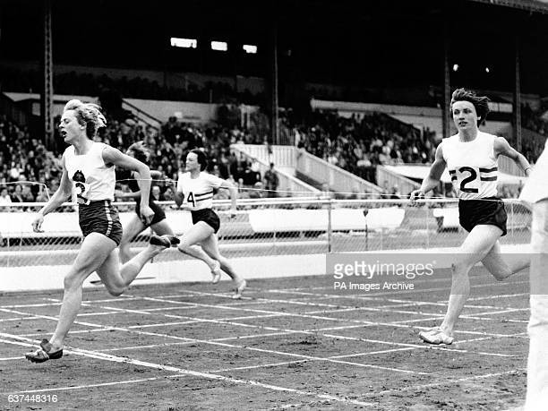 Australia's Betty Cuthbert wins the women's 220yds from Great Britain's Heather Young