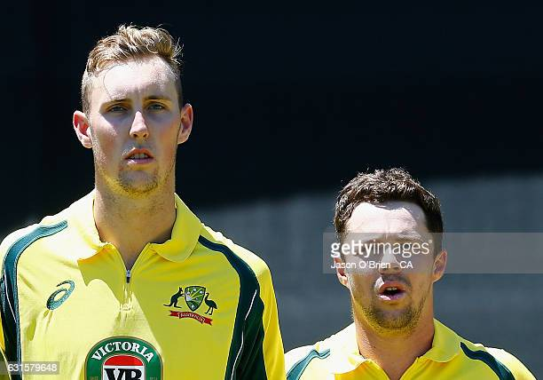 Australia's Billy Stanlake and Travis Head during game one of the One Day International series between Australia and Pakistan at The Gabba on January...