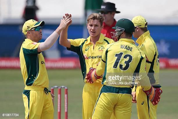 Australia's bowler Adam Zampa celebrates with teammates the dismissal of Ireland's batsman William Porterfield during Australia against Ireland ODI...