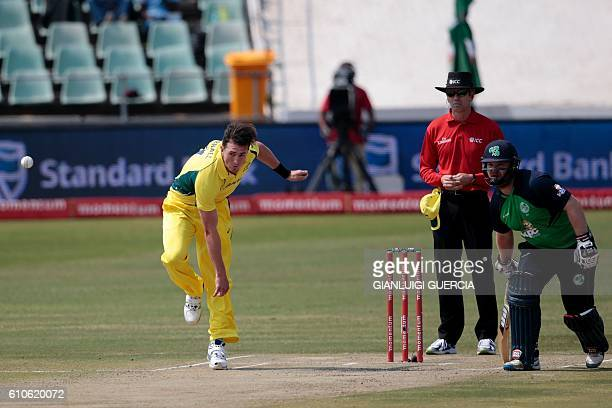 Australia's bowler Daniel Worrall bowls on Ireland batsman William Porterfield as Ireland batsman Paul Stirling looks on on September 27 2016 at...