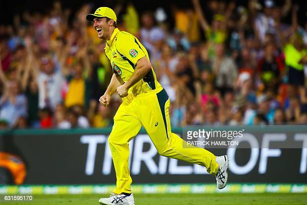 Australia's bowler Mitchell Marsh celebrates his catch to dismiss Pakistan'sMohammad Rizwan during the oneday international cricket match between...