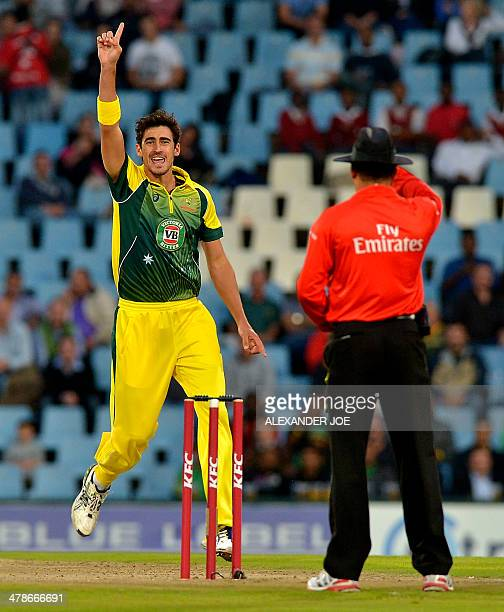 Australia's bowler Mitchell Starc celebrates the wicket of South Africa's batsman Hashim Amla during the final Twenty20 cricket match between South...