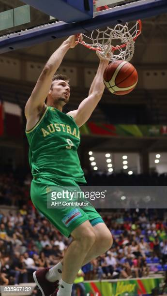 Australia's Brad Newley dunks the ball against Iran during their 2017 FIBA Asia Cup Final Basketball match in town of Zouk Mikael north of Beirut on...