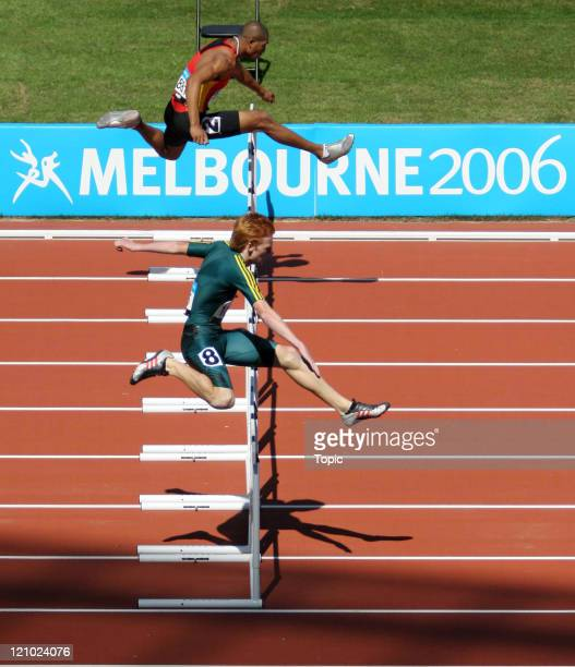 Australia's Brendan Cole and South Africa's Pieter De Villiers compete in the 400m Men's Hurdles during the Commonwealth Games at the Melbourne...