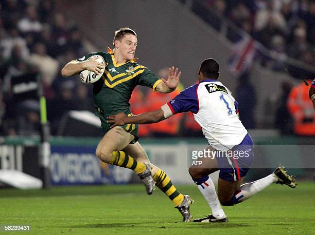 Australia's Brent Tate hands off Great Britain's Leon Pryce to score the third try for Australia in the Rugby League TriNations Series 19 November...