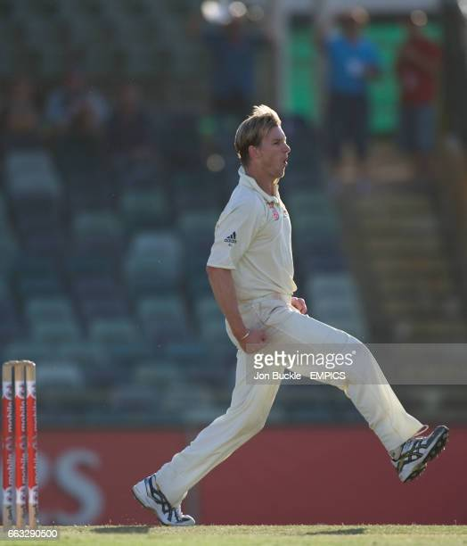 Australia's Brett Lee celebrates claiming the wicket of South Africa's Hashim Amla on day four of the first test