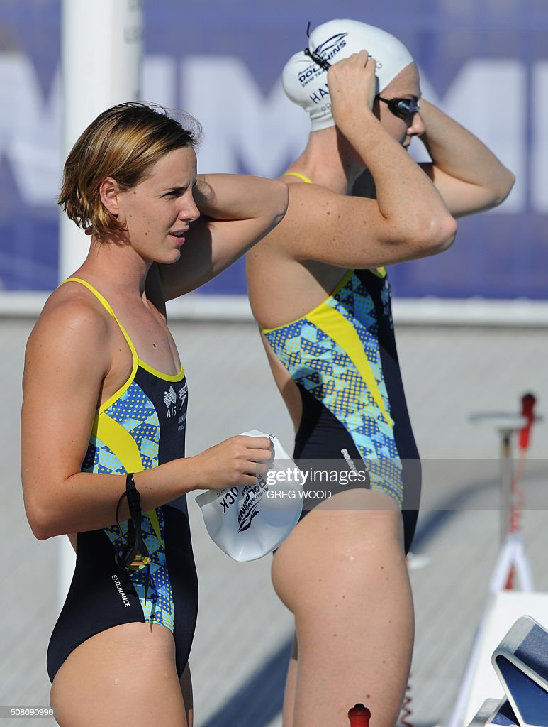Australia's Bronte Campbell (L) and sister Cate (R), prepare for a warm up prior to the start of the final day of the Aquatic Super Series swimming event in Perth on February 6, 2016. AFP PHOTO / Greg WOOD WOOD