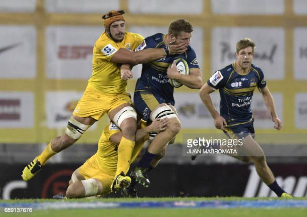 Australia's Brumbies lock Blake Enever runs through a tackle by Argentina's Jaguares lock Tomas Lavanini during their Super Rugby match at Jose...