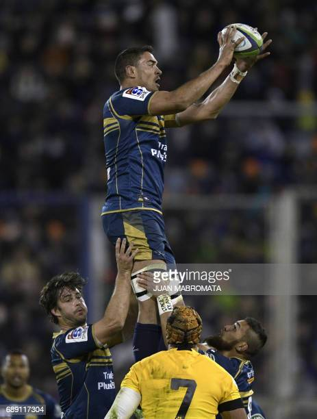 Australia's Brumbies lock Rory Arnold reaches for the lineout ball against Argentina's Jaguares flanker Juan Manuel Leguizamon during their Super...