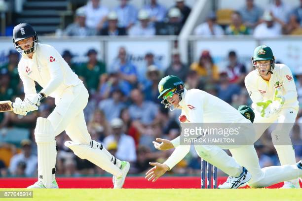 Australia's Cameron Bancroft fields as England's batsman James Vince and Australia's wicketkeeper Tim Paine look on during the first day of the first...