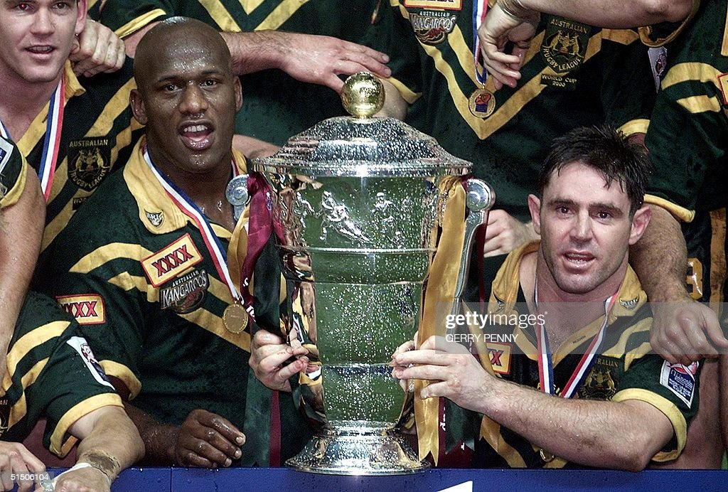 Australia's captain Brad Fittler and Man of the Match Wendell Sailor celebrate 25 November 2000 after beating New Zealand 4012 to win the Rugby...