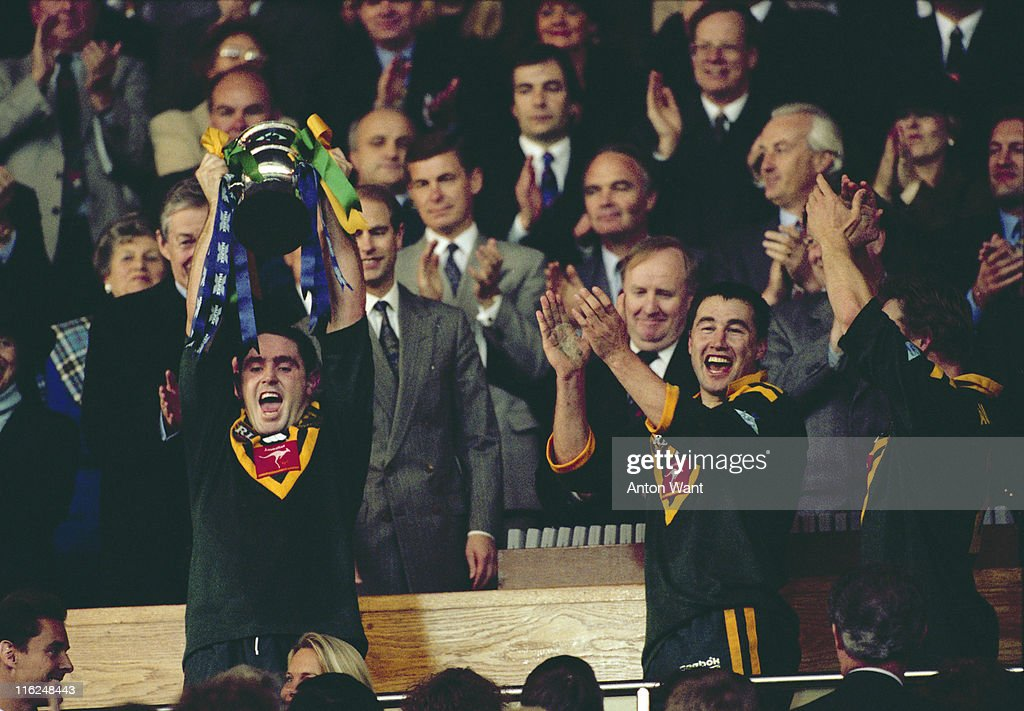 Australia's captain Brad Fittler raises the trophy after Australia beat England 8-16 in the final of the Rugby League World Cup at Wembley Stadium, London, 28th October 1995. Prince Edward, Earl of Wessex, is standing just behind.