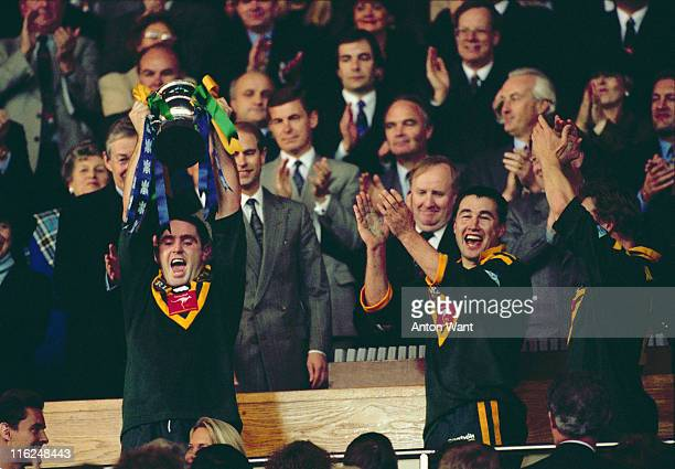 Australia's captain Brad Fittler raises the trophy after Australia beat England 816 in the final of the Rugby League World Cup at Wembley Stadium...