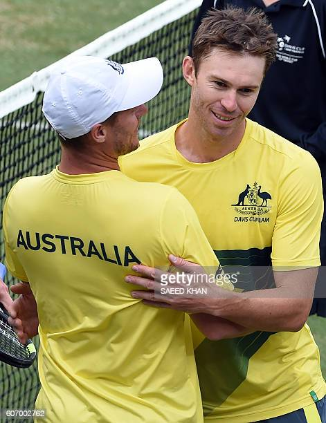 Australia's captain Lleyton Hewitt congratulates player John Peers after victory in the men's doubles tennis match against Slovakia's Andrej Martin...