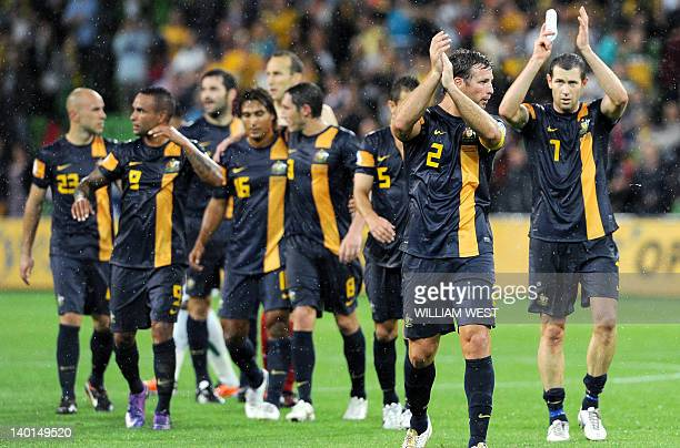 Australia's captain Lucas Neill and team acknowledge the applause after they defeated Saudi Arabia in their 2014 World Cup qualifying match in...