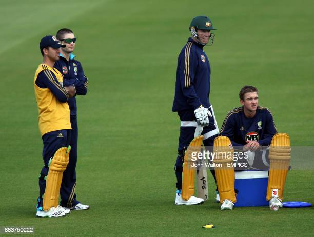 Australia's captain Ricky Ponting and Michael Clarke watch the nets session