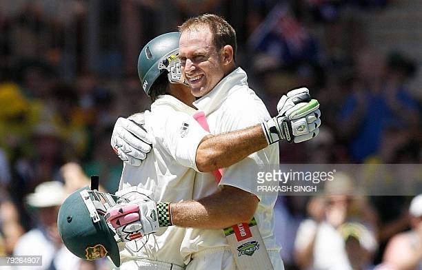 Australia's captain Ricky Ponting congratulates Mathew Hayden for his century against India during day three of the fourth and final Test match at...