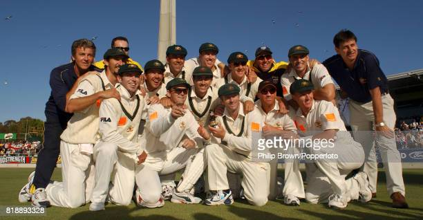 Australia's captain Steve Waugh surrounded by the rest of his team holds a replica Ashes urn after Australia retained the Ashes following victory in...