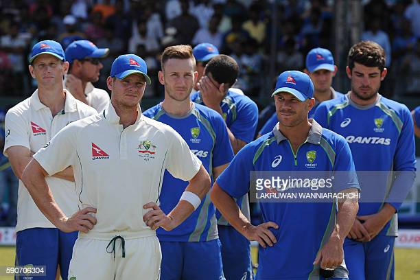 Australia's captain Steven Smith and teammates look on during the presentation ceremony after Sri Lanka's victory in the third and final Test match...