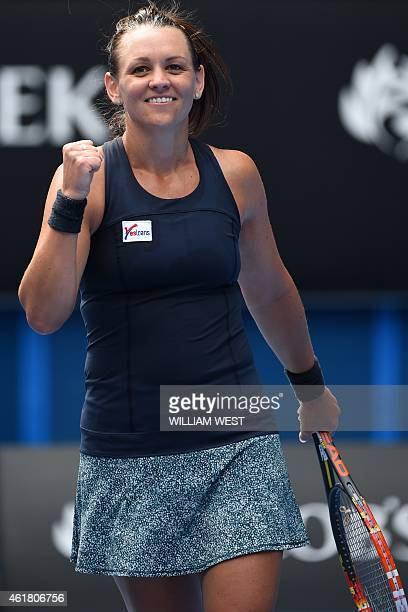 Australia's Casey Dellacqua celebrates after victory in her women's singles match against Austria's Yvonne Meusburgeron day two of the 2015...