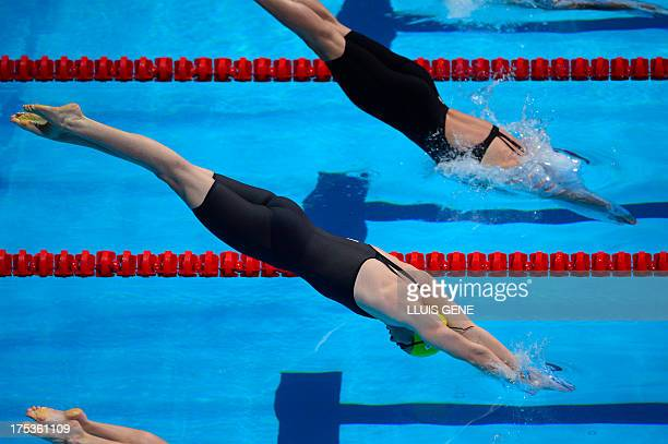 Australia's Cate Campbell dives as she competes in the heats of the women's 50metre freestyle swimming event in the FINA World Championships at Palau...
