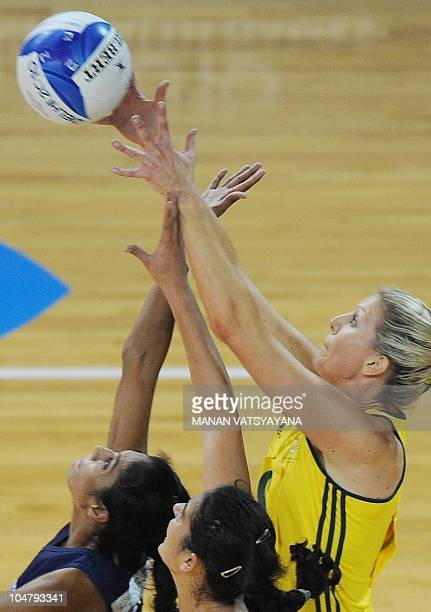 Australia's Catherine Cox vies for the ball with Indian players during a women's group match in the XIX Commonwealth Games at the Thyagaraj Stadium...