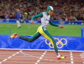 Australia's Cathy Freeman crosses the finish line to win the gold medal in the Women's 400m Final at the Sydney 2000 Olympic Games September 25 2000...