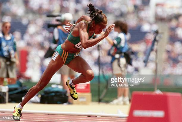 Australia's Cathy Freeman explodes from the starting blocks in a preliminary heat of the women's 400meter run at the 1996 Olympic Games in Atlanta...
