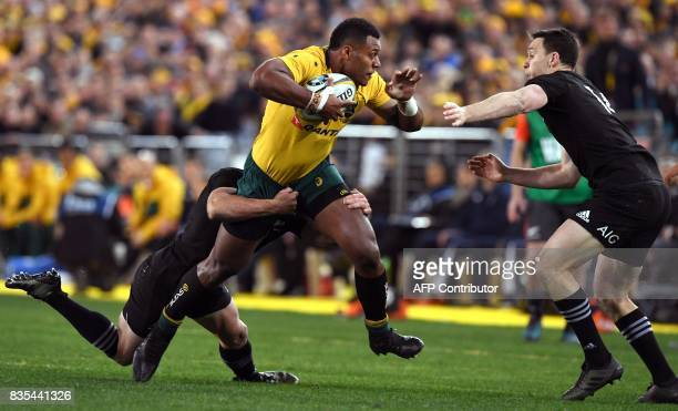 Australia's centre Samu Kerevi is tackled by New Zealand's centre Ryan Crotty and wing Ben Smith during the Rugby Championship test match between...
