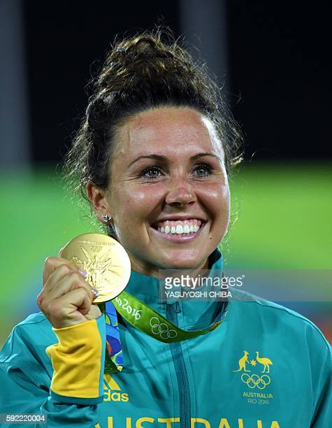 Australia's Chloe Esposito poses with her gold medal in the women's modern pentathlon at the Deodoro Stadium during the Rio 2016 Olympic Games in Rio...