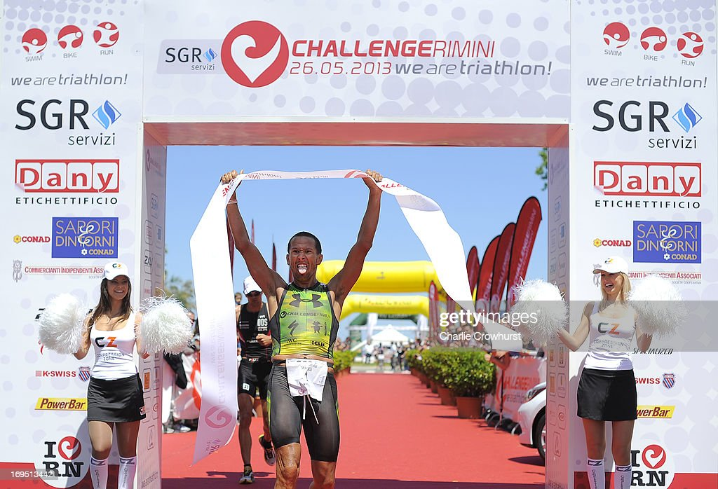 Australia's Chris McCormack celebrates after winning the men's race during the Challenge Family Triathlon Rimini on May 26, 2013 in Rimini, Italy.