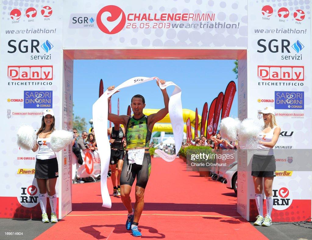 Australia's Chris McCormack celebrates after winning the men's race during the Challenge Family Triathlon Rimini on May 26, 2013 in Rimini, Italy.