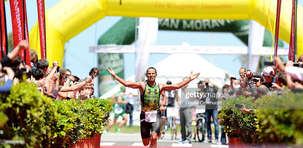 Australia's Chris McCormack celebrates after winning the mens race during the Challenge Family Triathlon Rimini on May 26, 2013 in Rimini, Italy.