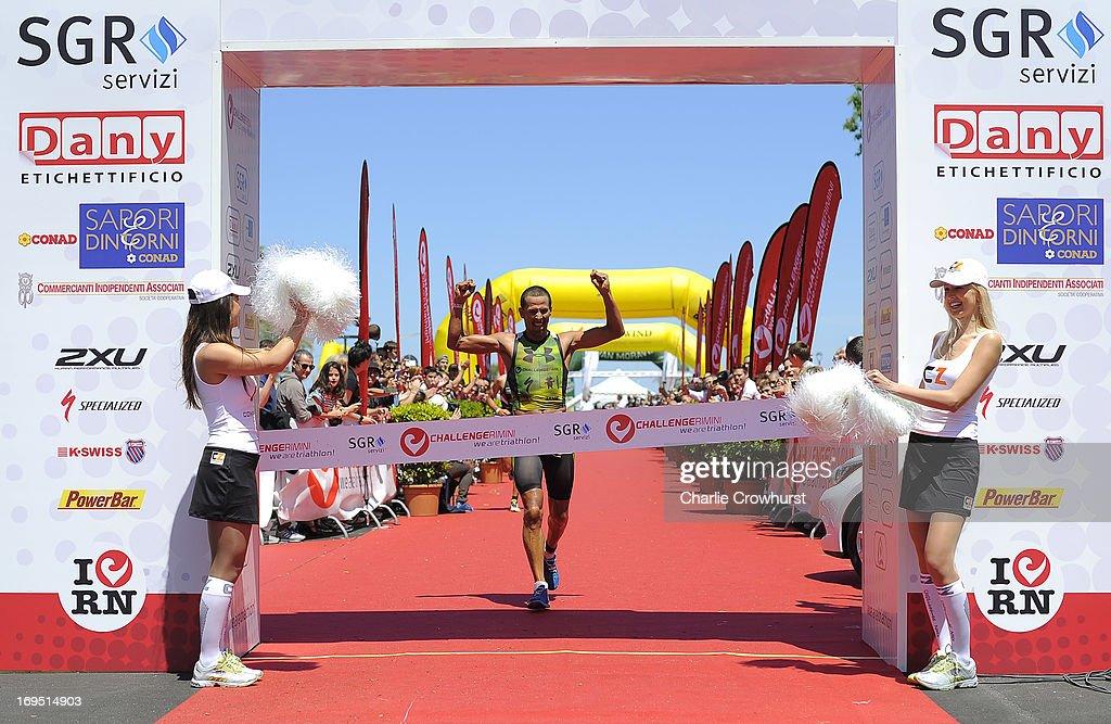 Australia's Chris McCormack celebrates winning the men's race during the Challenge Family Triathlon Rimini on May 26, 2013 in Rimini, Italy.