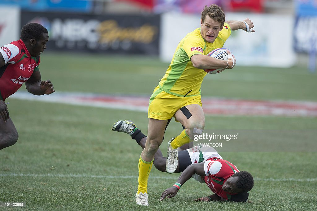 Australia's Con Foley vies with Kenya defenders during Day 3 of the USA Sevens Las Vegas HSBC Sevens World Series Round 5 at Sam Boyd Stadium in Las Vegas, NV, February 10, 2013. AFP PHOTO/Jim WATSON
