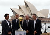 Australia's cricket team captain Michael Clarke laughs with former captains Ricky Ponting Steve Waugh and Allan Border as they gather around World...