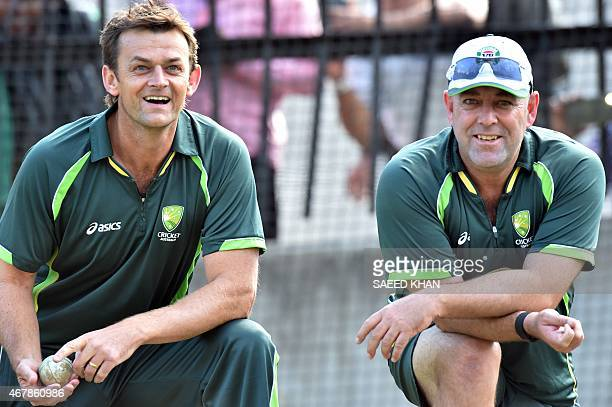 Australia's cricket team coach Darren Lehmann and former wicketkeeper Adam Gilchrist watch nets practice ahead of the 2015 Cricket World Cup final...